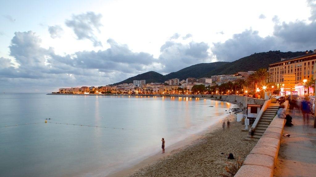 Ajaccio featuring a coastal town, a sandy beach and a sunset