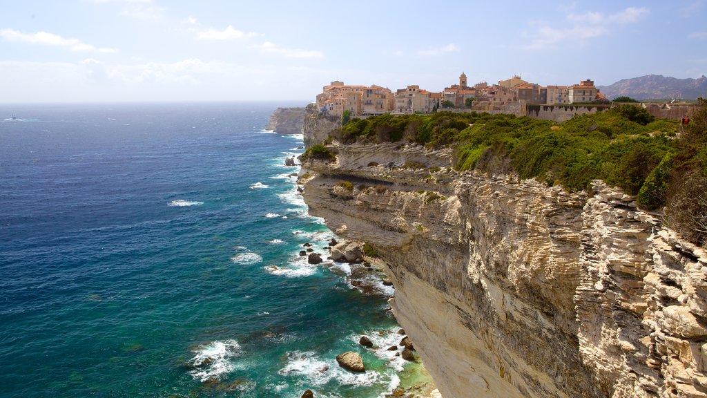 Bonifacio featuring a coastal town and rugged coastline
