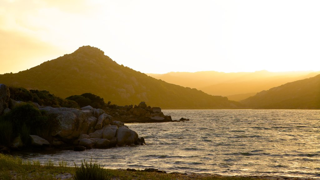 Balistra Beach showing a sunset and rocky coastline