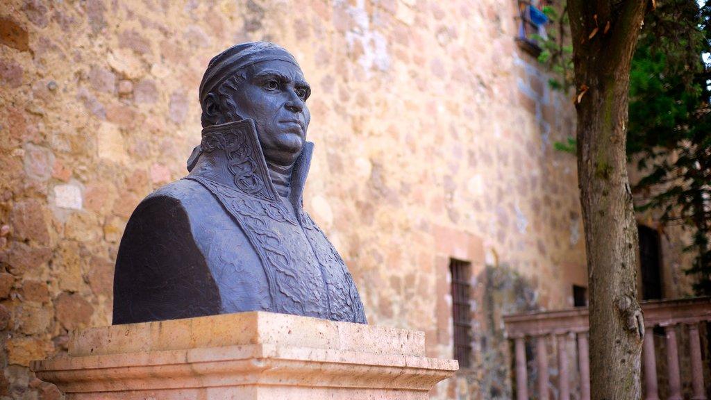 Casa Natal de Morelos featuring a memorial and a statue or sculpture