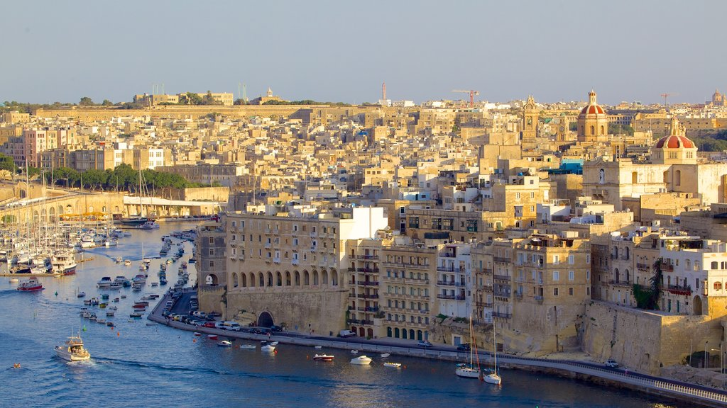 Valletta which includes a city, heritage architecture and a sunset