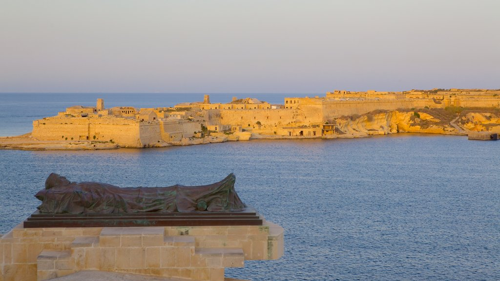 Grand Harbour which includes a bay or harbor, a sunset and a coastal town