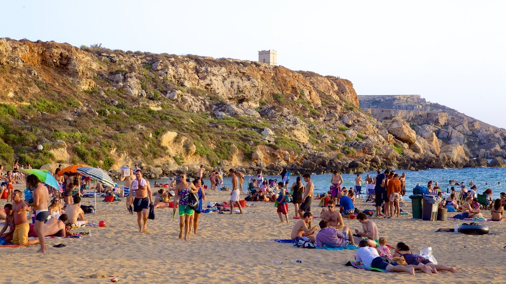 Golden Sands Beach featuring a beach as well as a large group of people