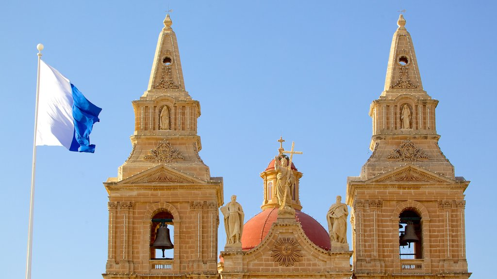 Mellieha Church which includes heritage architecture, religious aspects and a church or cathedral