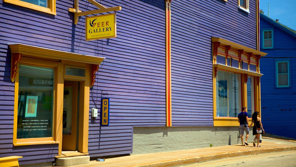 Lunenburg showing signage and street scenes as well as a couple