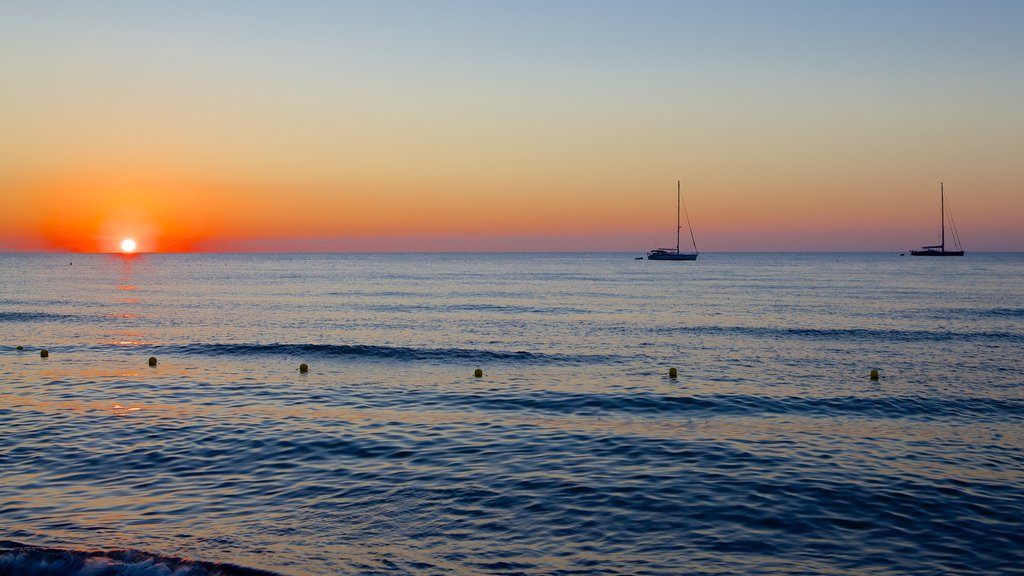 Cefalu showing general coastal views and a sunset