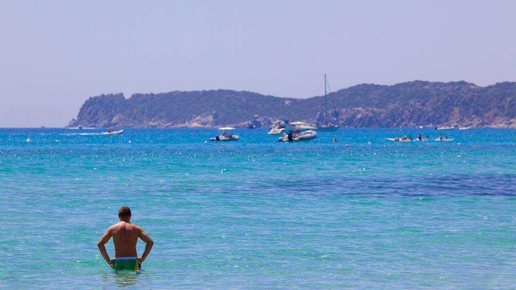 Playa Simius mostrando natación, costa rocosa y vistas generales de la costa