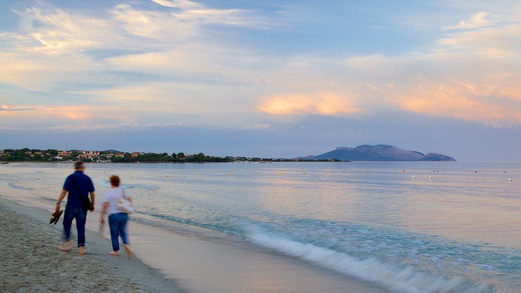 Playa de Pittulongu mostrando una puesta de sol y una playa y también una pareja