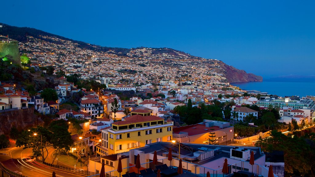 Funchal which includes night scenes and a coastal town