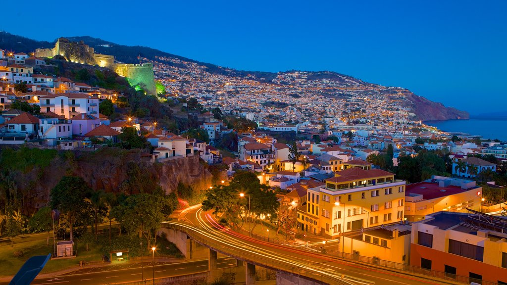Funchal featuring a coastal town and night scenes