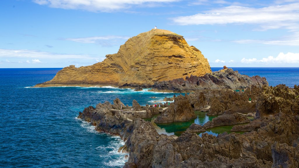 Porto Moniz Natural Pools which includes rugged coastline