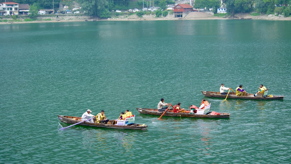 Nainital Lake showing a lake or waterhole and kayaking or canoeing as well as a large group of people