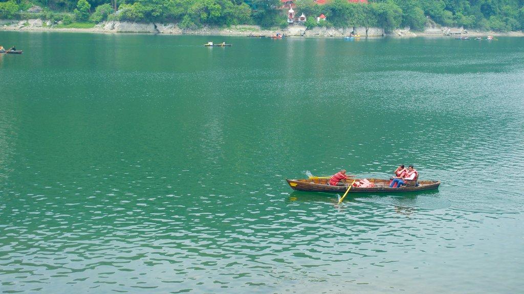 Nainital Lake featuring kayaking or canoeing and a lake or waterhole