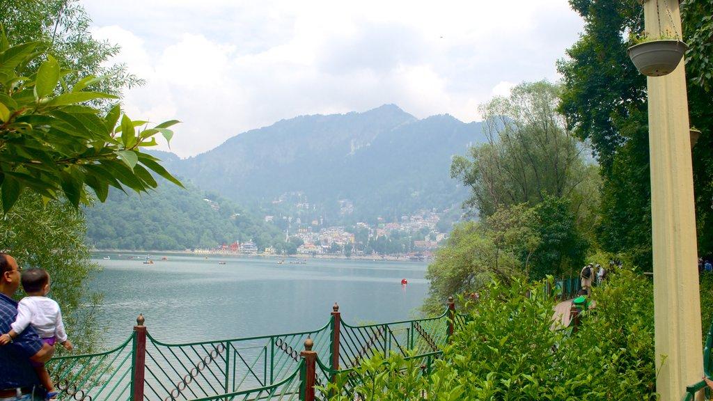 Nainital Lake featuring mountains and a lake or waterhole