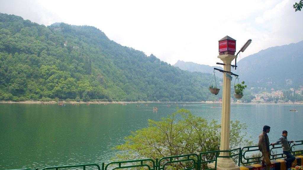 Nainital Lake featuring a lake or waterhole and mountains