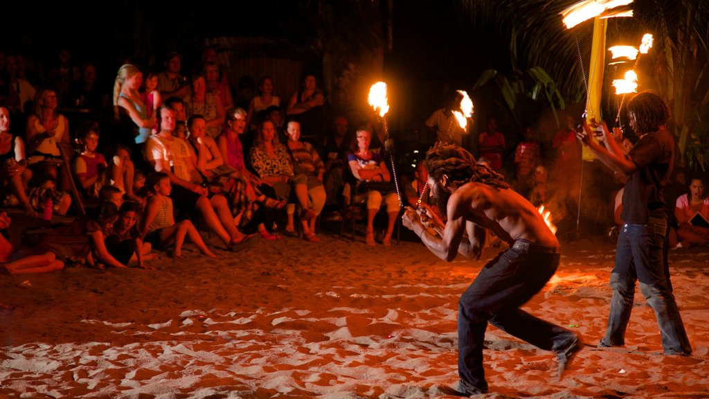 Efate showing night scenes and performance art as well as a large group of people