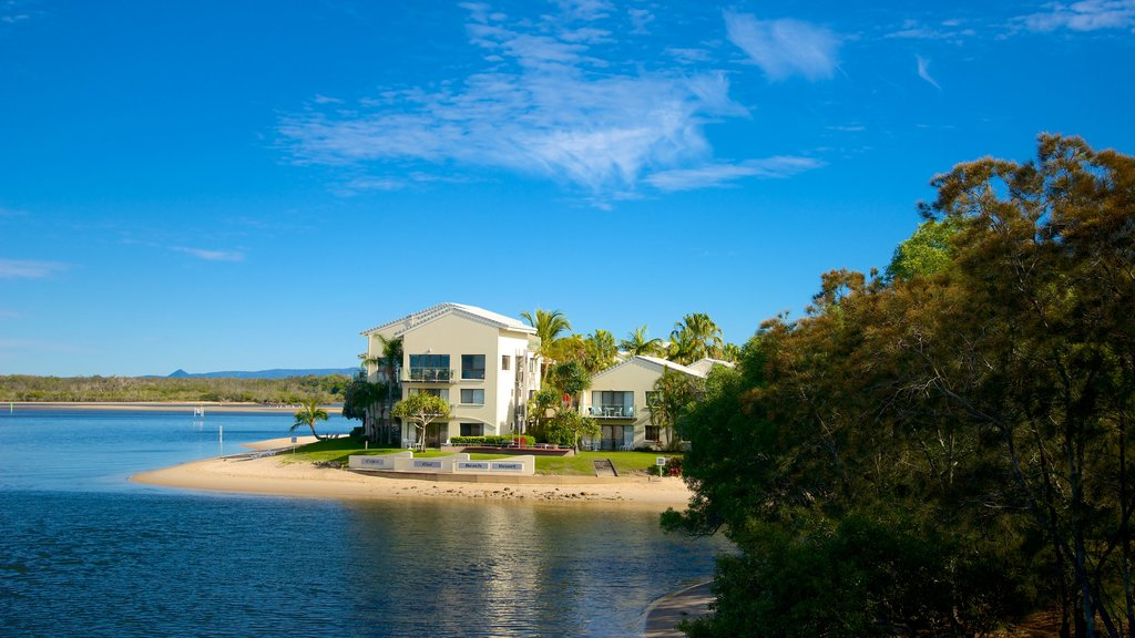 Noosa which includes general coastal views and a house