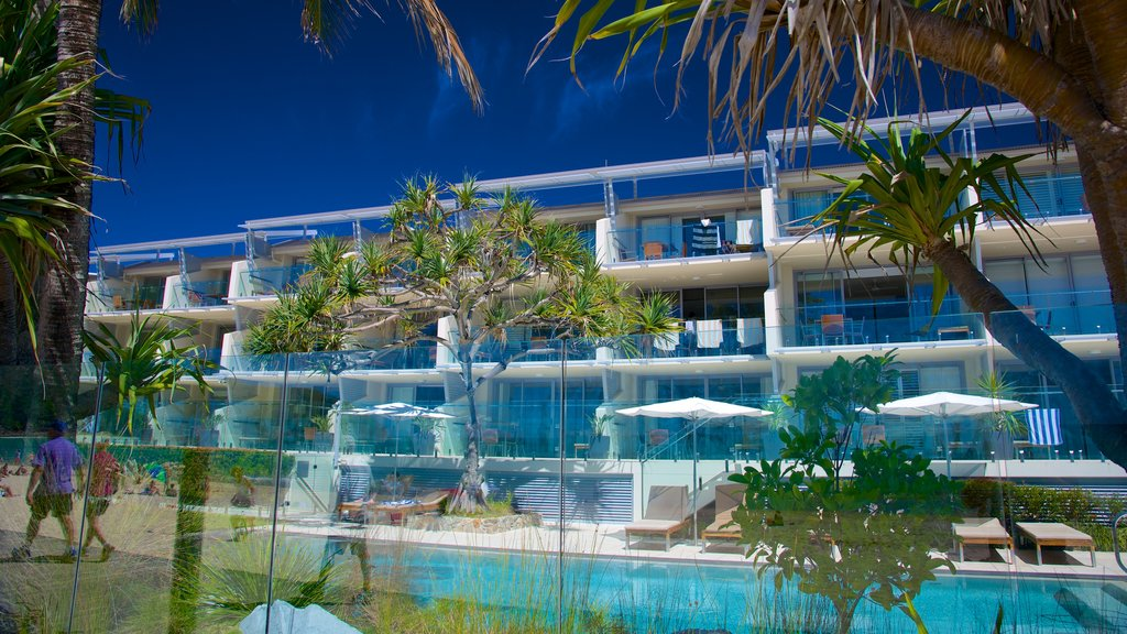 Noosa Beach featuring a luxury hotel or resort and modern architecture