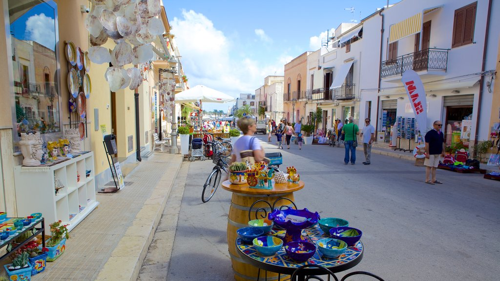 San Vito Lo Capo which includes street scenes and markets as well as a small group of people
