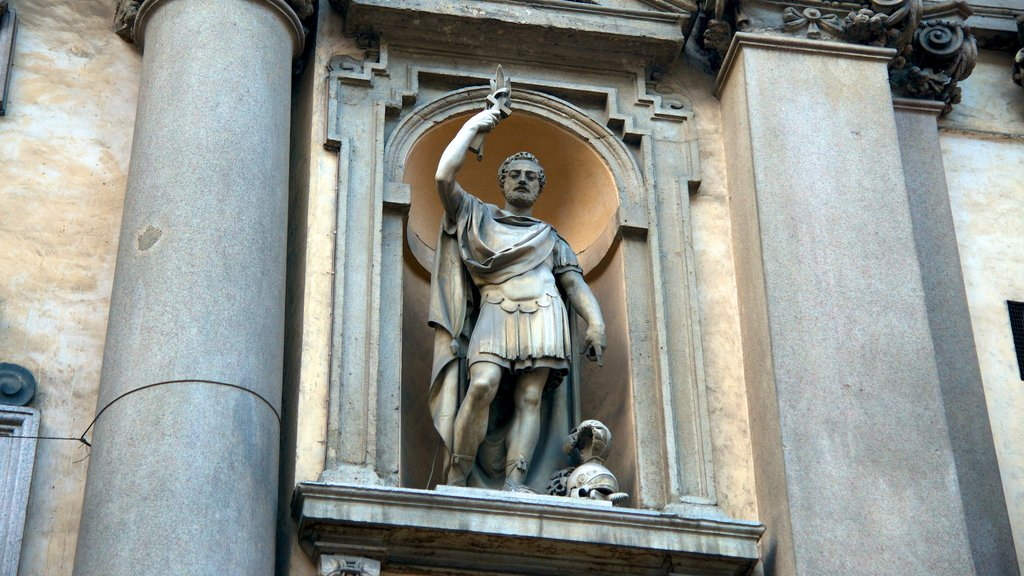 Chiesa di San Maurizio which includes a statue or sculpture and heritage architecture