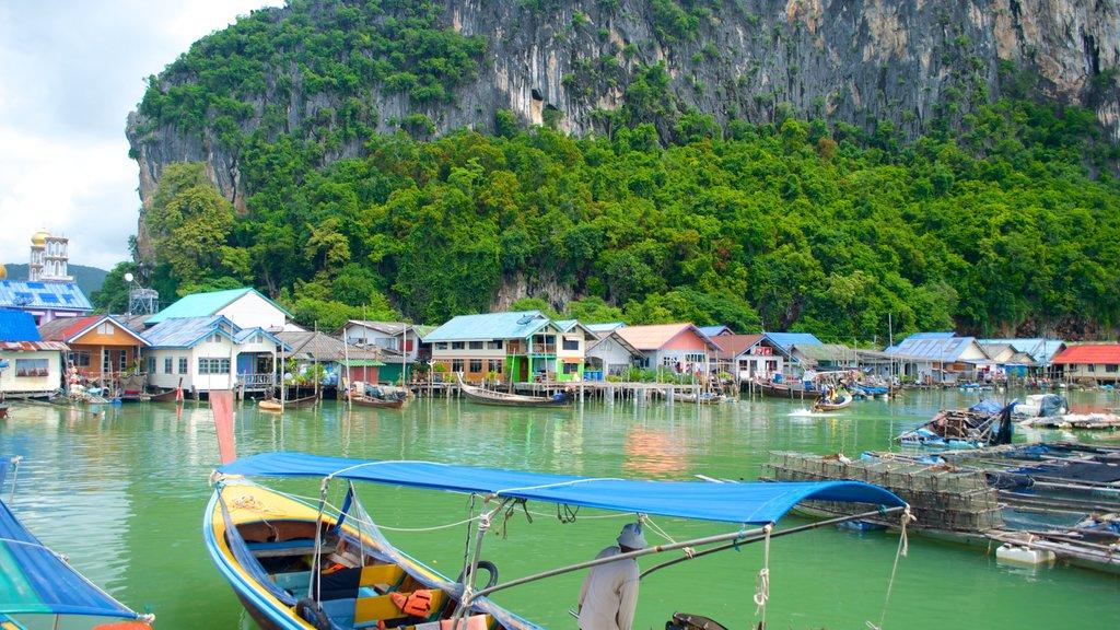 Phang Nga showing a coastal town, landscape views and boating