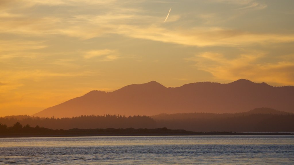 Tofino featuring mountains, a sunset and general coastal views