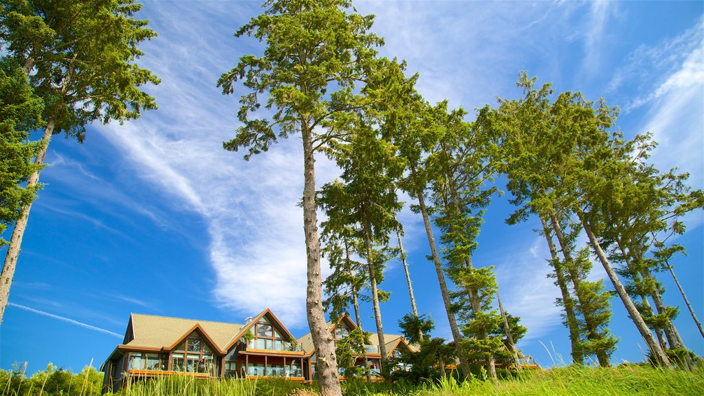 Ucluelet Big Beach showing a luxury hotel or resort and a house