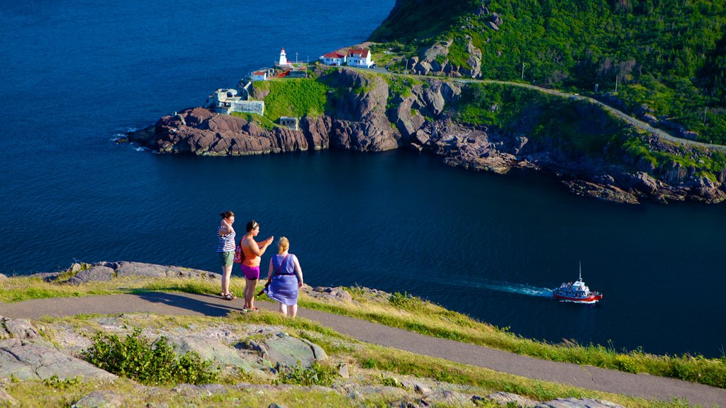 Signal Hill showing general coastal views as well as a small group of people