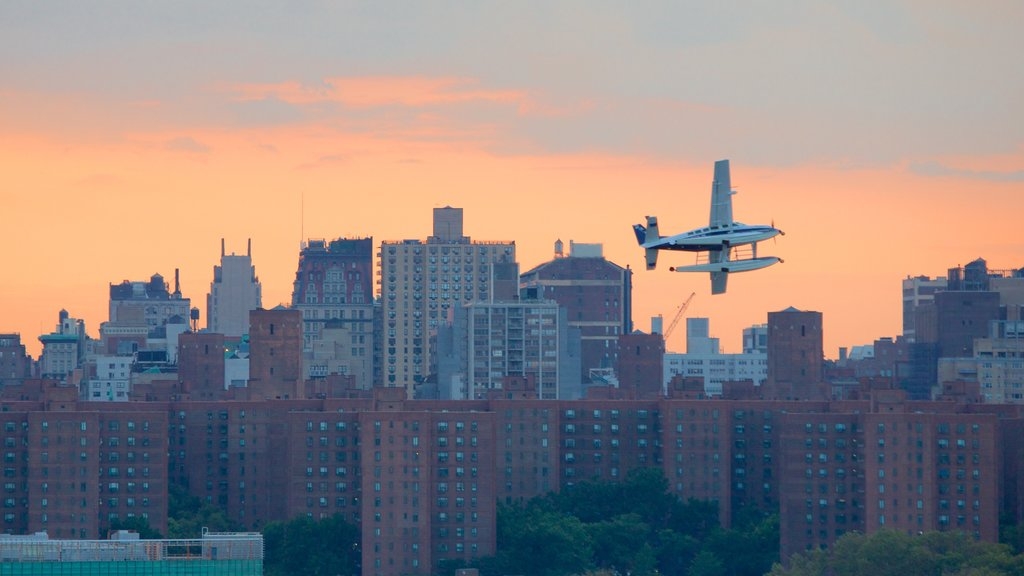 Brooklyn featuring a sunset, a city and aircraft