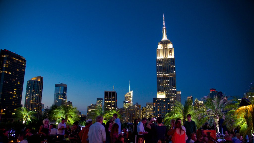 Empire State Building which includes skyline, nightlife and a city