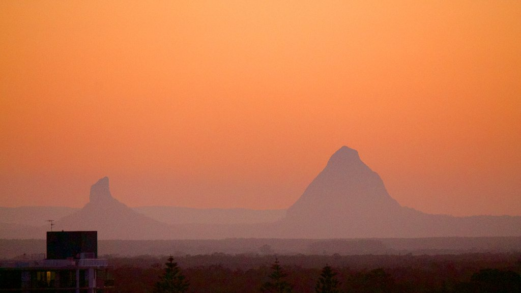 Glasshouse Mountains National Park which includes a sunset, mountains and landscape views