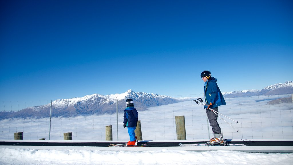 Coronet Peak Ski Area featuring snow and snow skiing as well as children