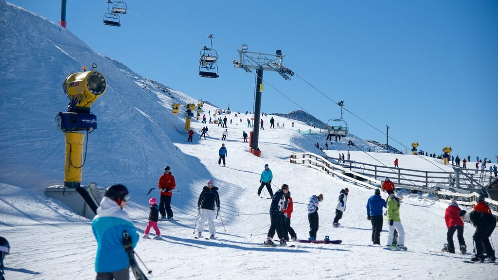 Coronet Peak Ski Area featuring a gondola, snow boarding and snow