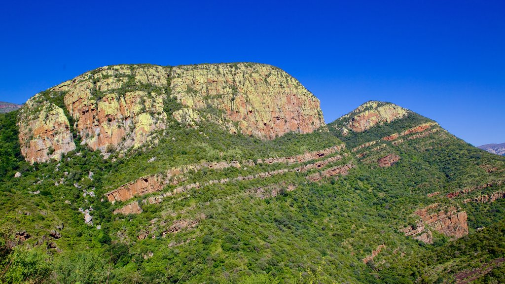 Mpumalanga - Limpopo which includes mountains and tranquil scenes