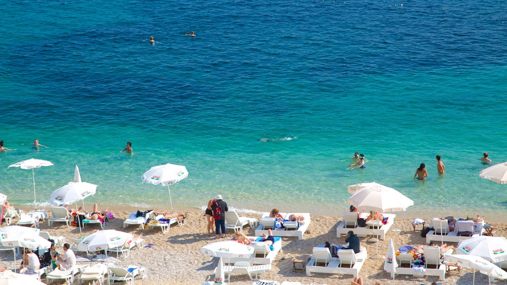 Dubrovnik - Southern Dalmatia featuring a sandy beach as well as a small group of people