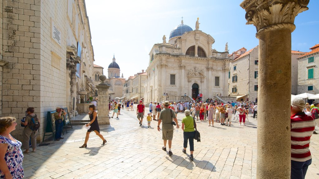 Sponza Palace which includes a square or plaza and heritage architecture as well as a large group of people