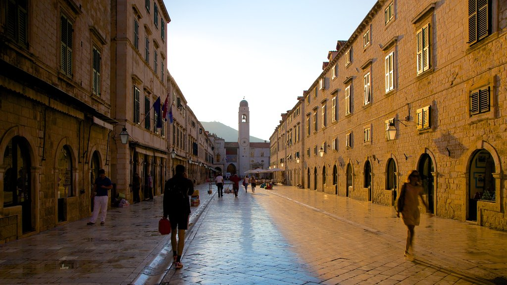 Stradun showing heritage architecture and street scenes as well as a small group of people