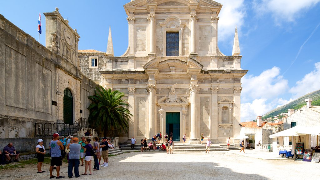 Church of St. Ignatius showing a church or cathedral and heritage architecture as well as a small group of people
