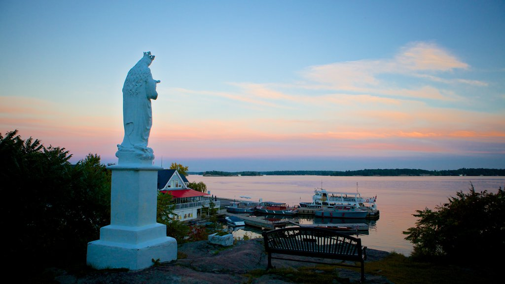 Rockport showing a statue or sculpture, a sunset and a lake or waterhole