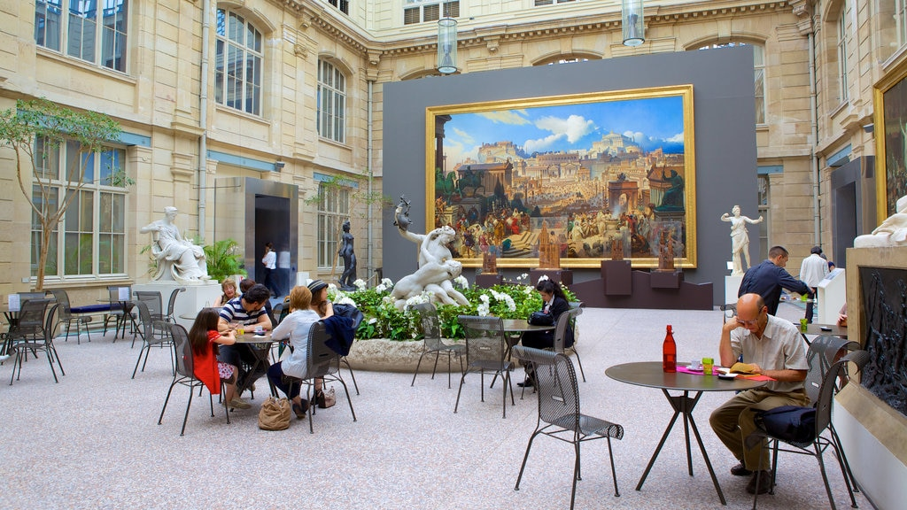 Musee des Beaux-Arts featuring a square or plaza and a statue or sculpture as well as a small group of people