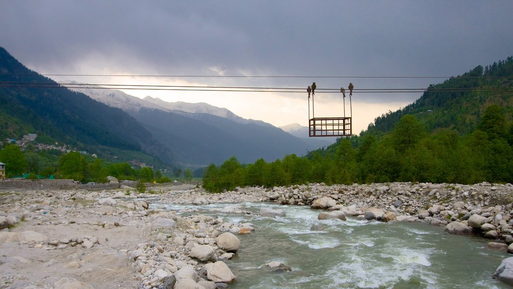 Manali which includes a river or creek and landscape views