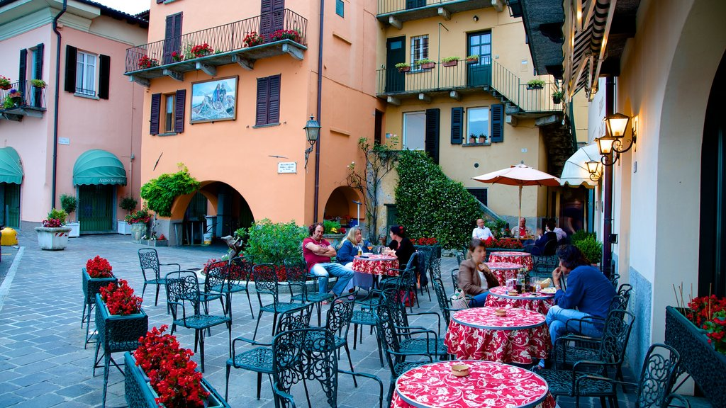 Menaggio which includes cafe scenes and outdoor eating as well as a small group of people