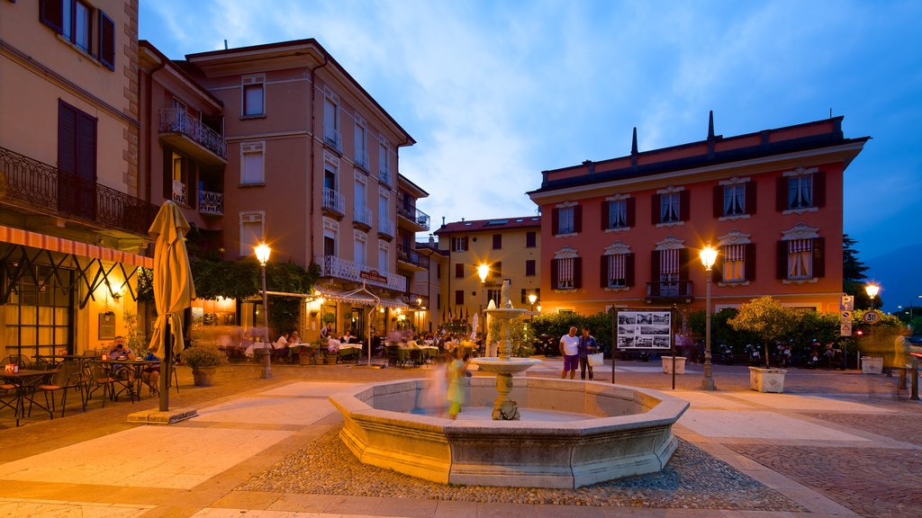 Menaggio which includes a fountain and a city