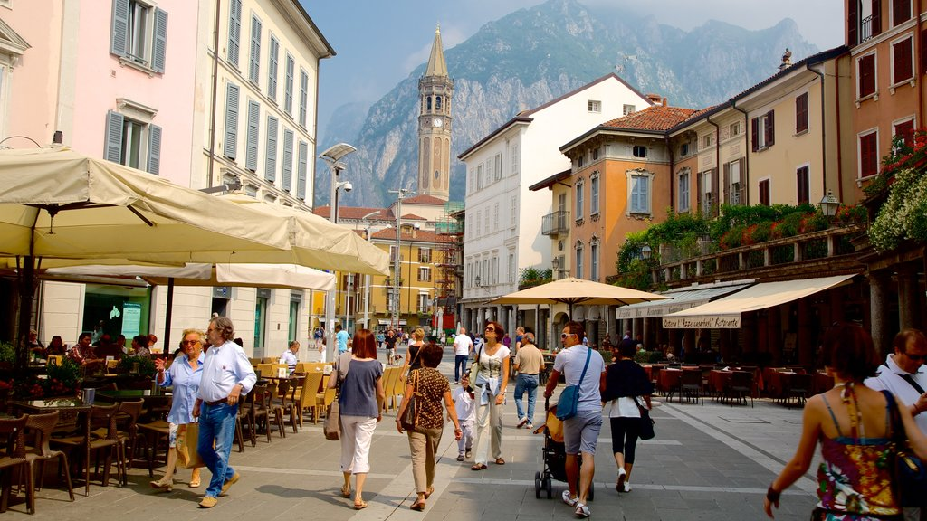 Lecco showing outdoor eating as well as a large group of people