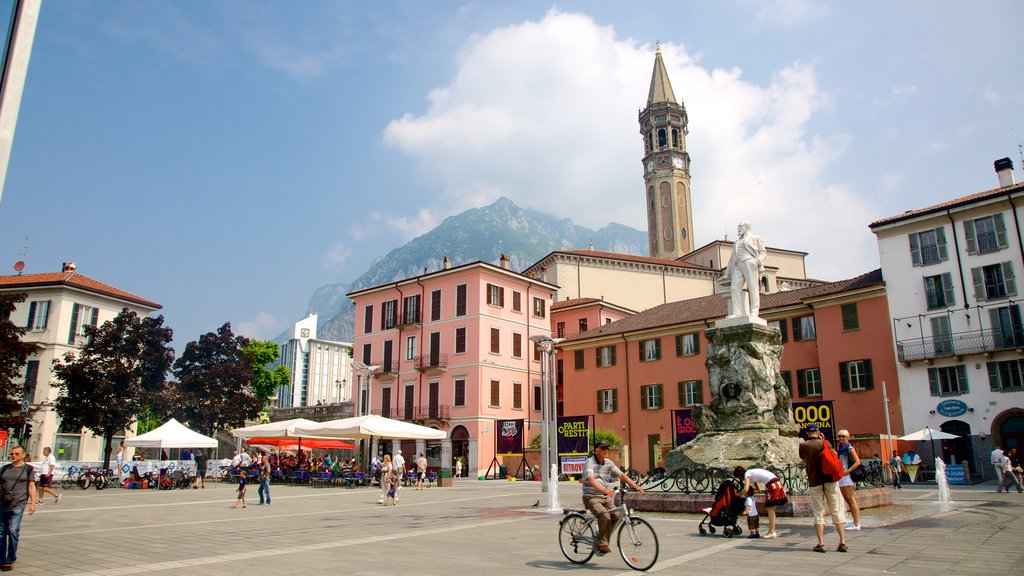 Lecco featuring a square or plaza, a fountain and a statue or sculpture
