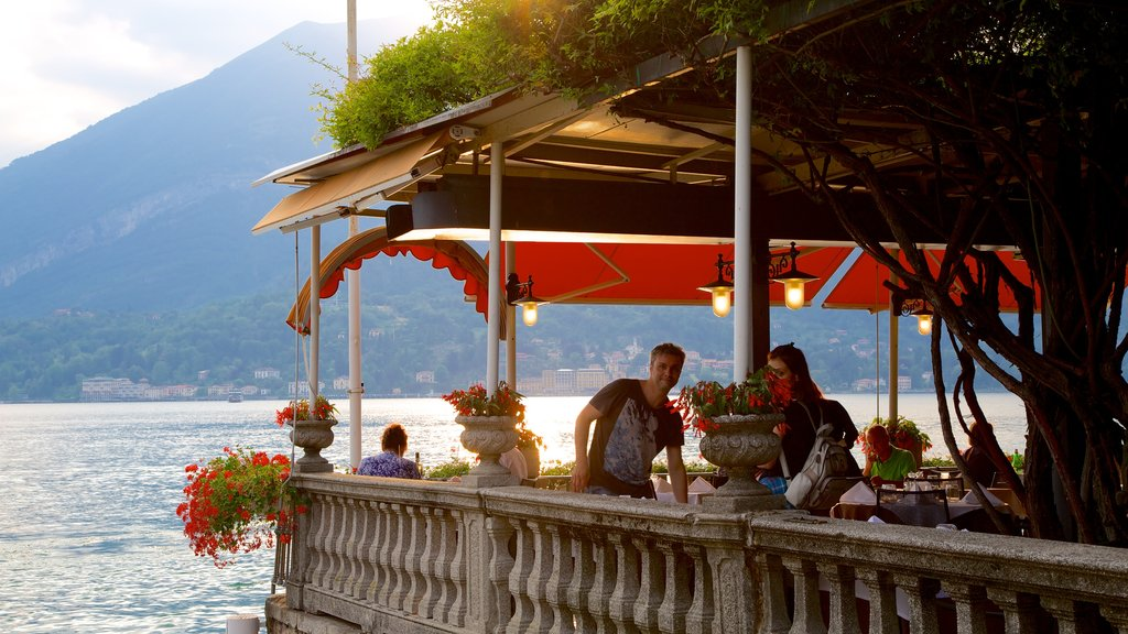 Bellagio featuring outdoor eating and a lake or waterhole as well as a small group of people