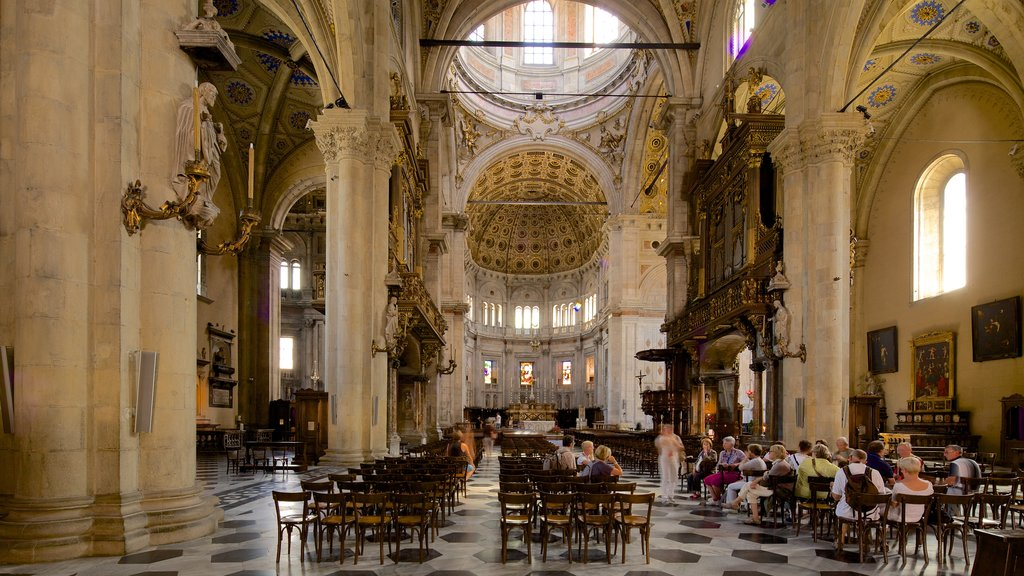 Lake Como featuring interior views and a church or cathedral as well as a large group of people
