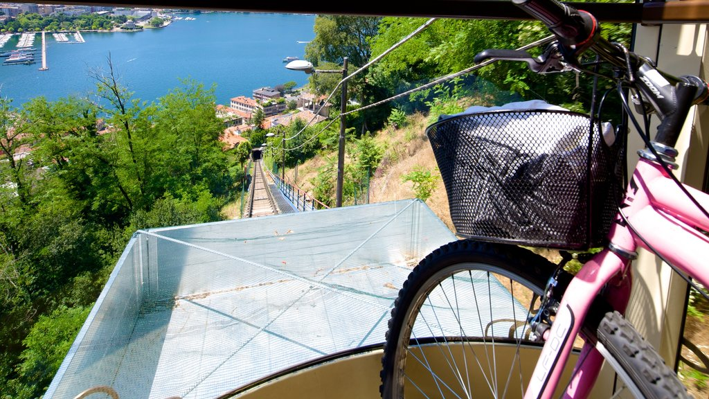 Como-Brunate Funicular featuring cycling and a coastal town