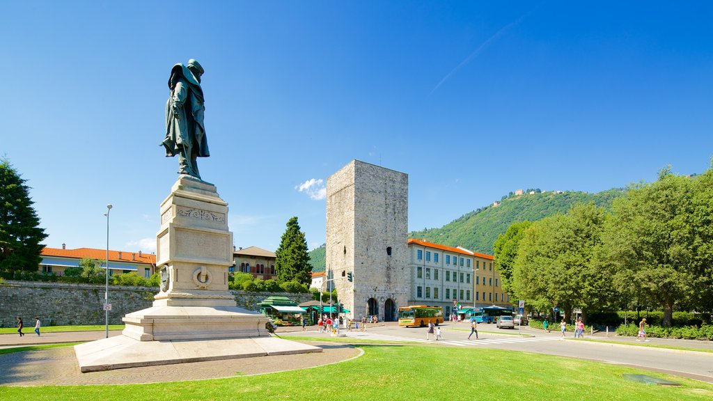 Piazza Vittoria which includes a square or plaza, a statue or sculpture and a monument