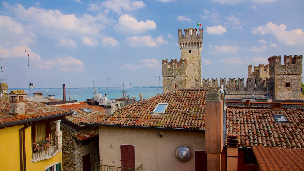 Sirmione showing general coastal views, a coastal town and a castle
